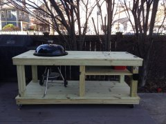 Custom woodworking a grill holder and table.